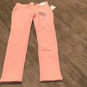 Tommy Bahamas's pink stretchy soft knit jeans